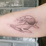 Surfing whale tattoo