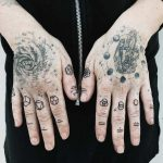 Tattooed hands by Pony Reinhardt