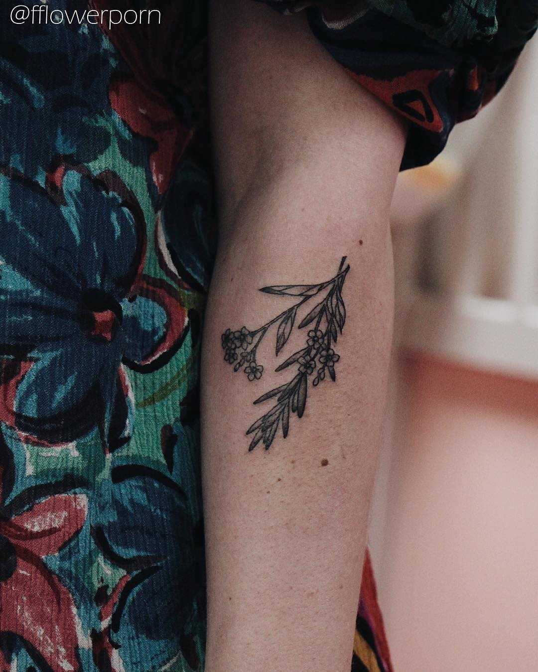 Tiny rosemary and forget me not tattoo