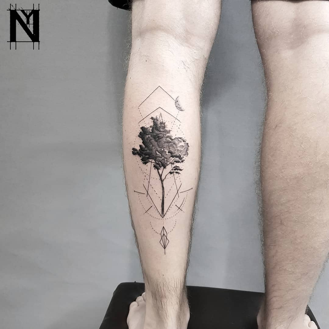 Tree tattoo on the left calf
