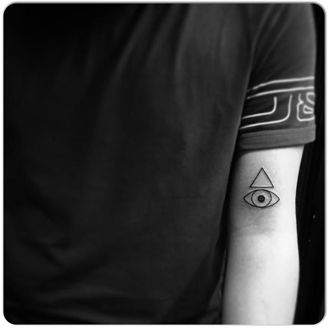 Triangle and eye tattoo