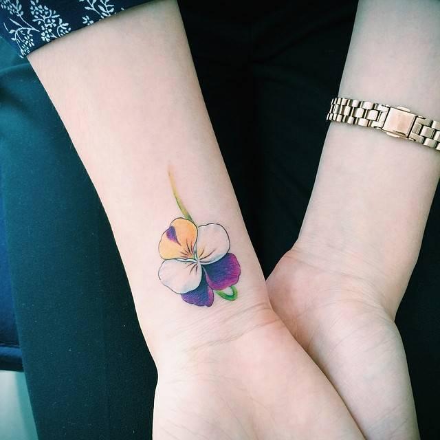 Violet tattoo on the wrist