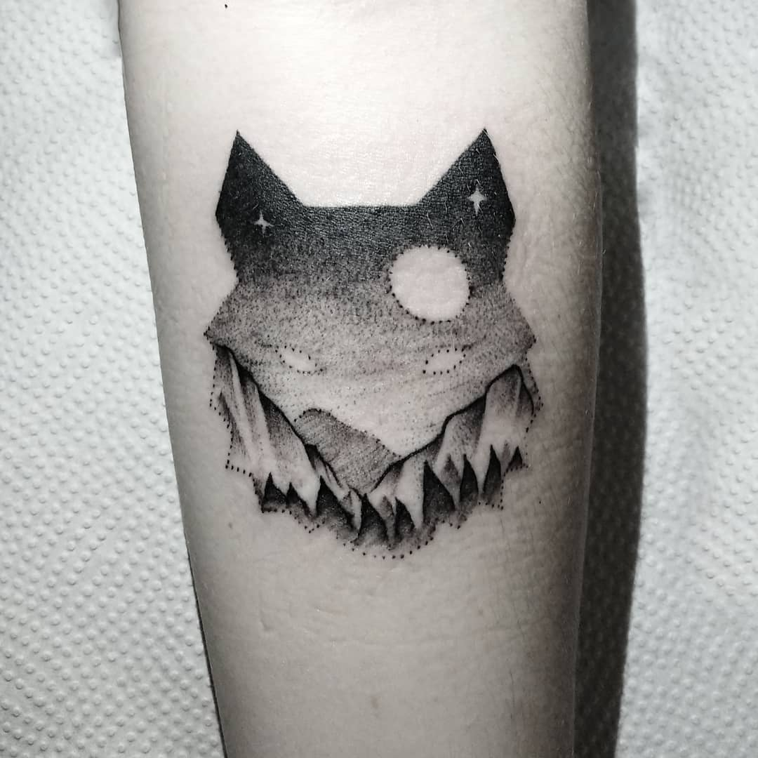 Wolf and mountains tattoo