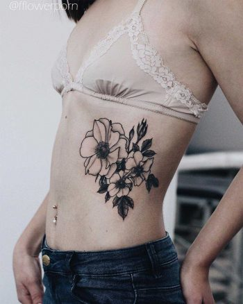 Anemone and wild roses tattoo