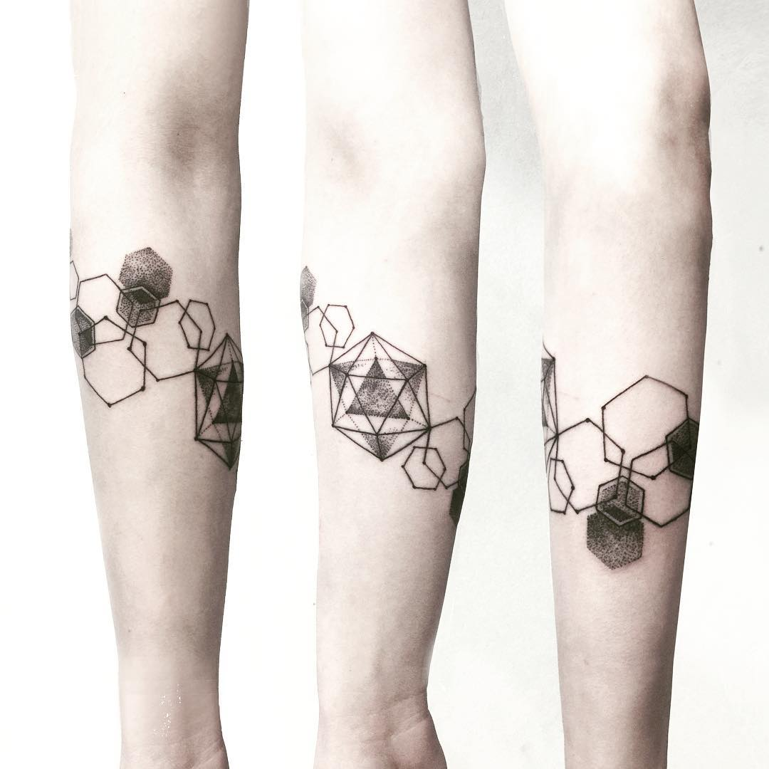 Asymmetry tattoo on the forearm