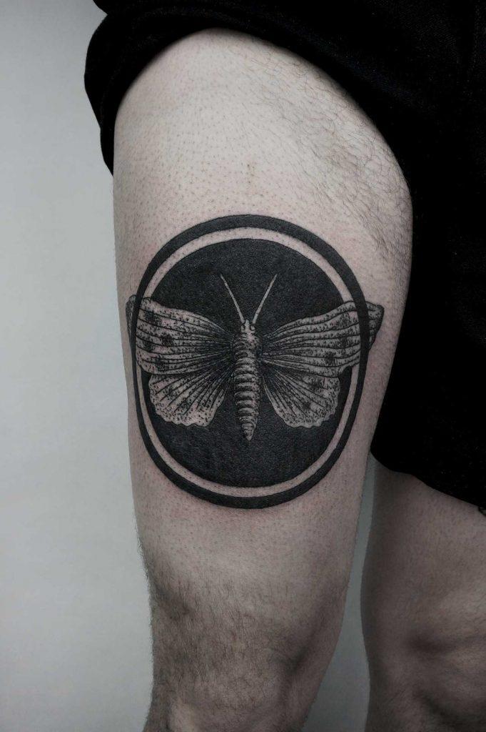 Black circle moth tattoo by SVA
