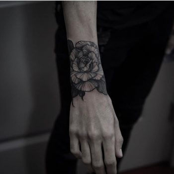 Black rose tattoo by Silveira Tattooer