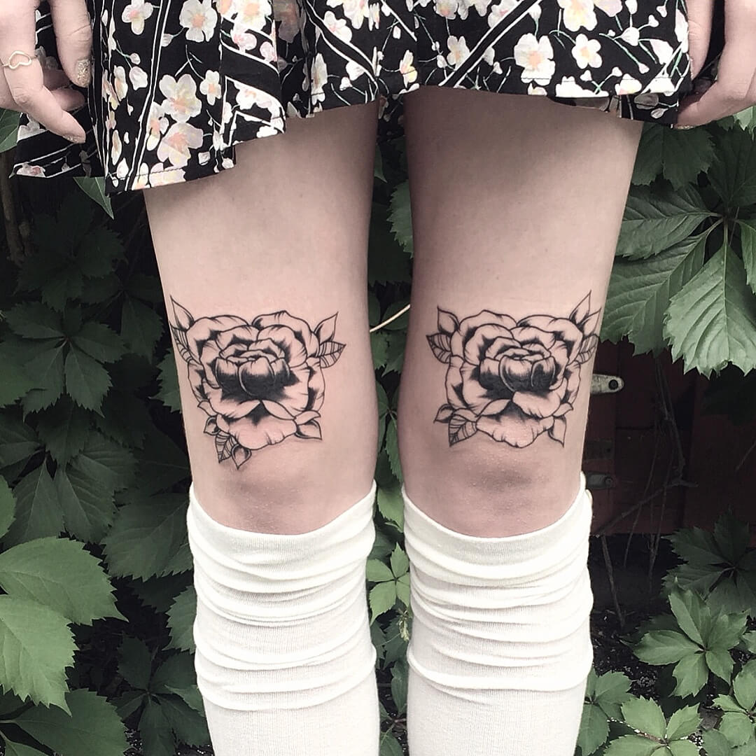 Black roses on both thighs