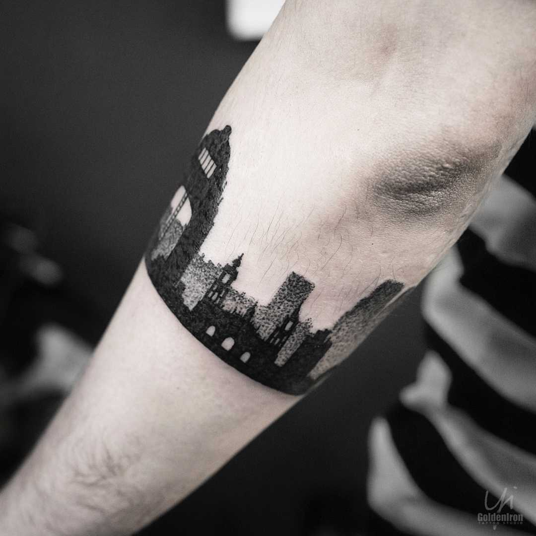 Blackwork cityscape tattoo
