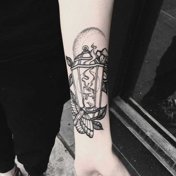 Blackwork lantern and moth tattoo