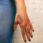 Blue eucalyptus tattoo by Kelli Kikcio