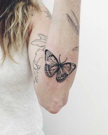 Butterfly tattoo on the left forearm
