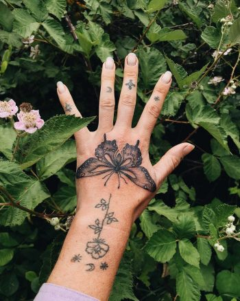 Butterfly tattoo on the left hand