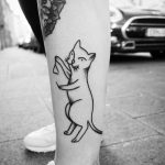 Cat triangle player tattoo