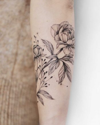 Classic botanical tattoo
