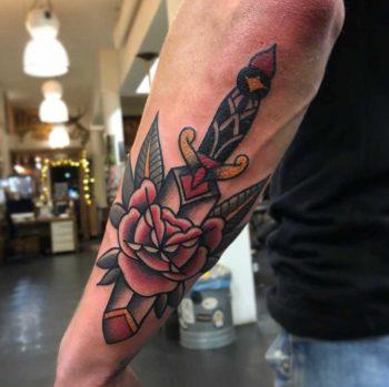 Classy dagger and rose tattoo