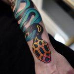 Colorful snake tattoo by Aleksy Marcinów