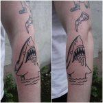 Cool shark tattoo on a forearm