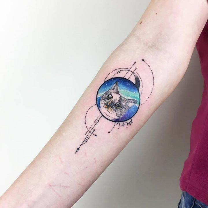 Cosmic kitten tattoo by Baris Yesilbas