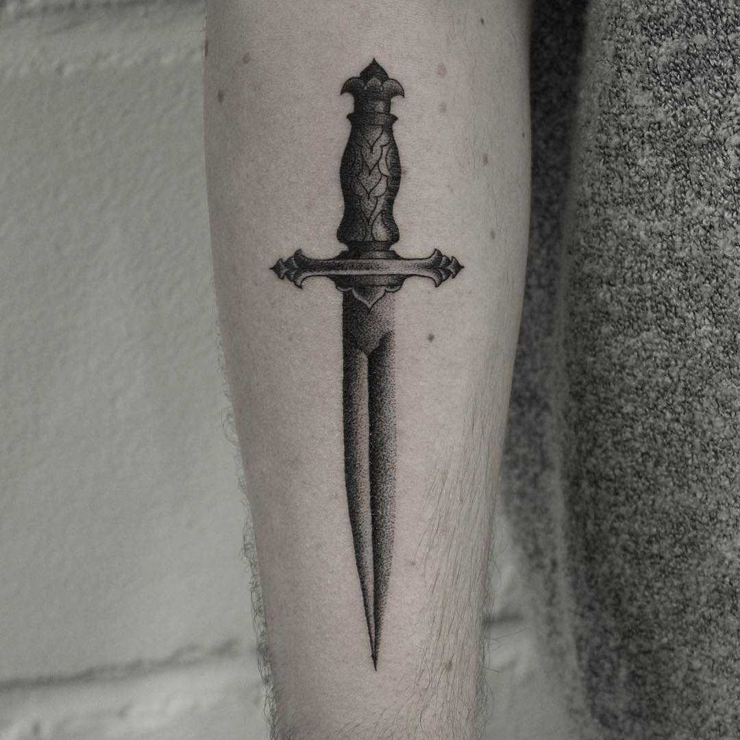 Dagger tattoo by Oliver Whiting