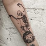 Dancing skeleton and cauldron tattoo