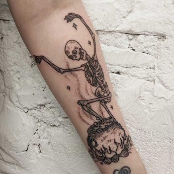 Dancing skeleton and cauldron tattoo