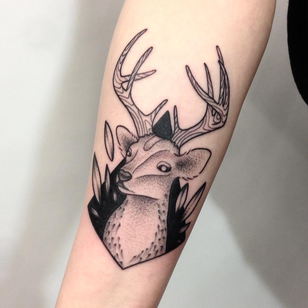 Deer portrait tattoo