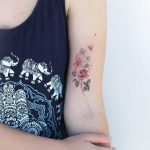 Delicate flower bouquet tattoo