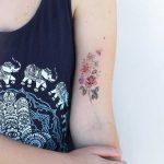 Delicate flower bouquet tattoo