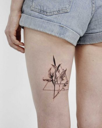 Delicate flowers and triangles tattoo