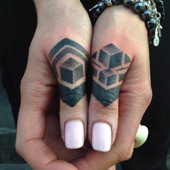 Dot-work thumb tattoos by Tamara Lee
