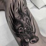 Dragon head tattoo done at Primordial Pain Tattoo Studio