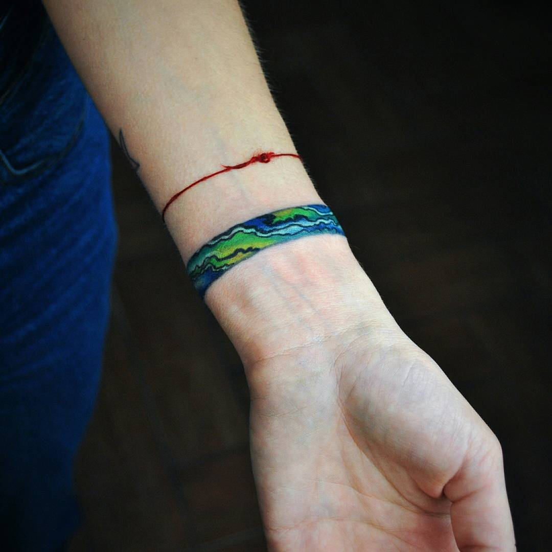 Earth-inspired bracelet tattoo by Valeria Yarmola