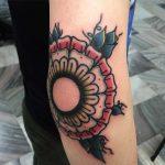 Elbow tattoo by Łukasz Krupiński