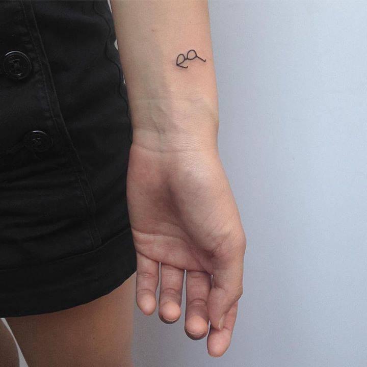 Eyeglasses tattoo on the wrist