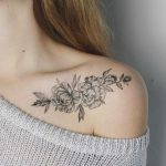 Floral tattoo on a collarbone