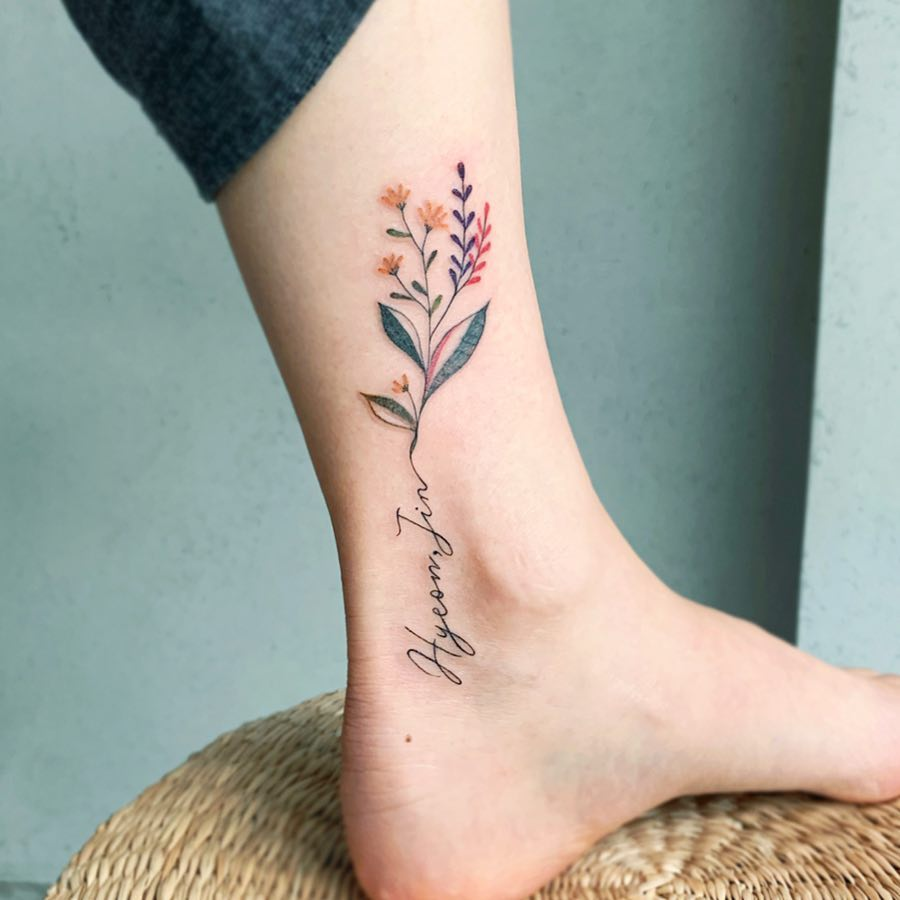 Flower and name ankle tattoo