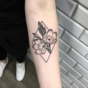 Flower in a rhombus on the forearm