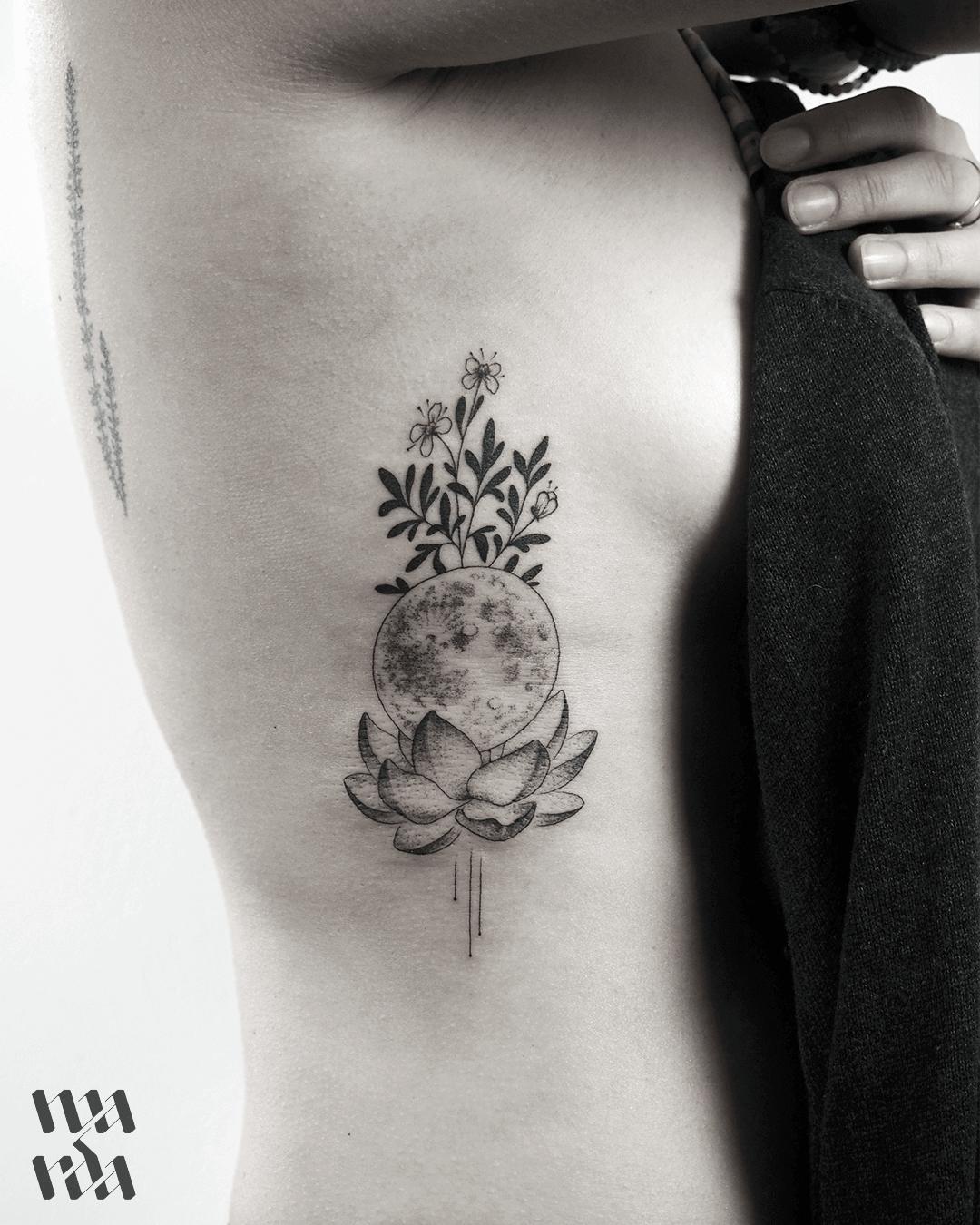 Full moon and Lotus flower tattoo