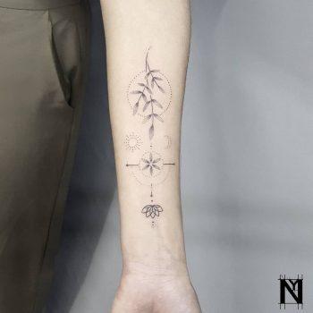 Gentle forearm tattoo by Noam Yona