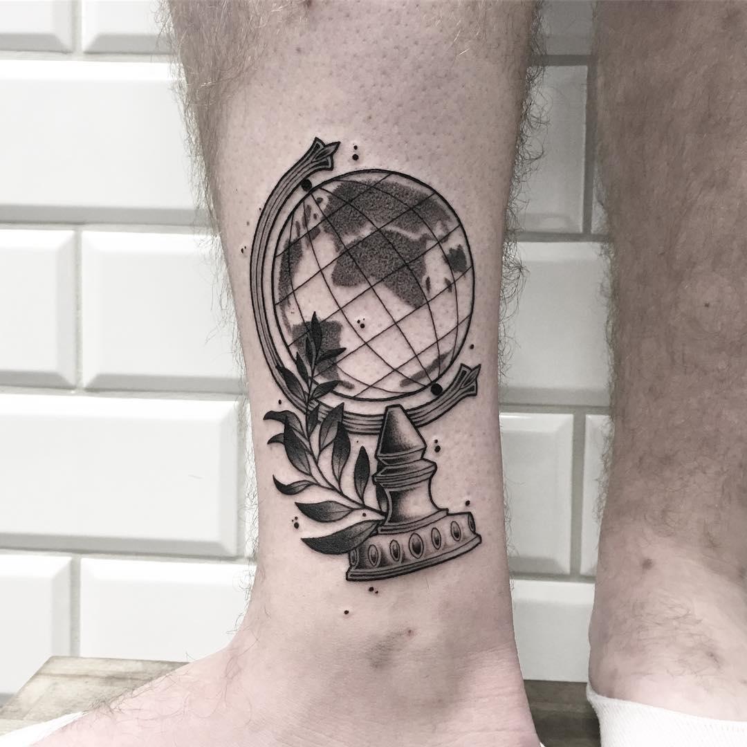 Globe tattoo on the ankle