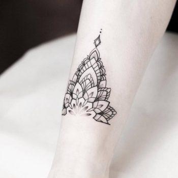 Half mandala ankle tattoo