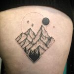 Hand-poked mountain scene by Kirk Budden