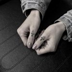 Hand-poked thumb tattoos by Oliver Whiting