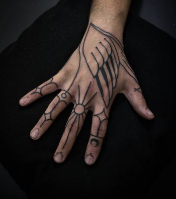 Hand tattoo by artist Meritattoon