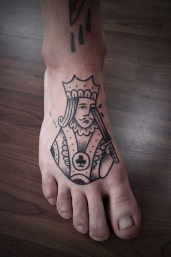 King tattoo on the foot