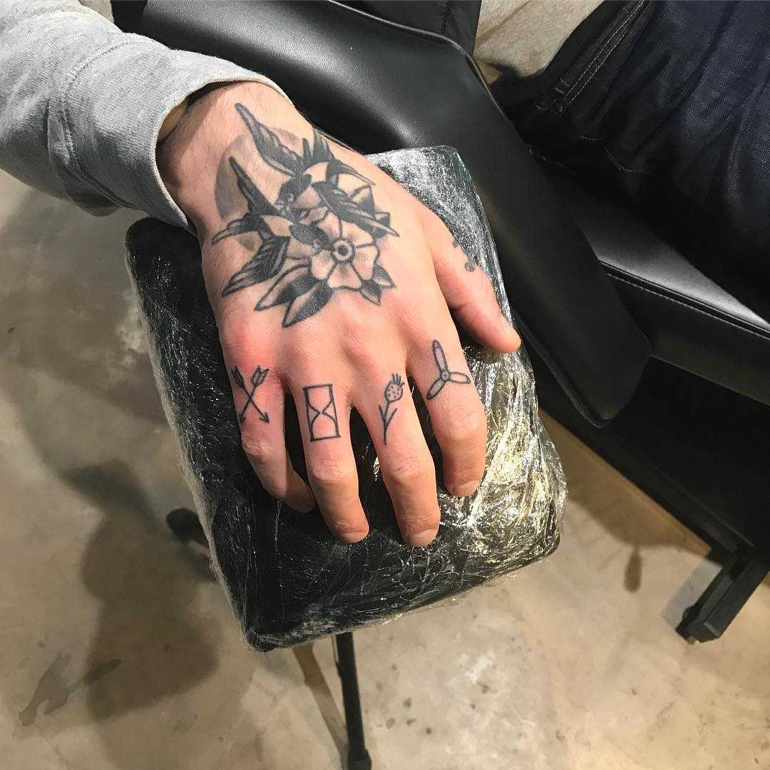 Knuckle tattoos by Kirk Budden