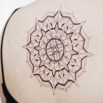 Large black and grey mandala tattoo on the back