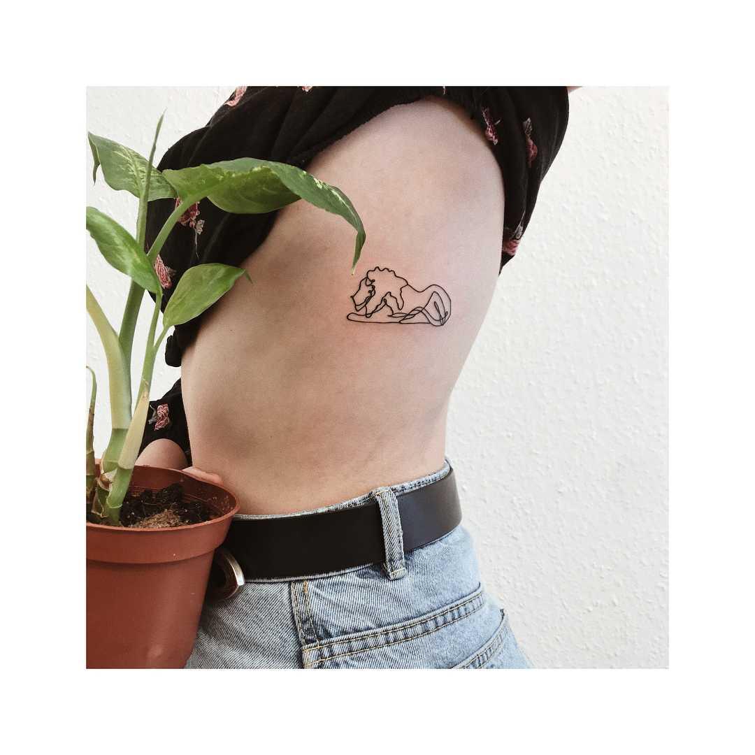 Linear lion tattoo