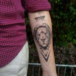 Lion and geometry tattoo